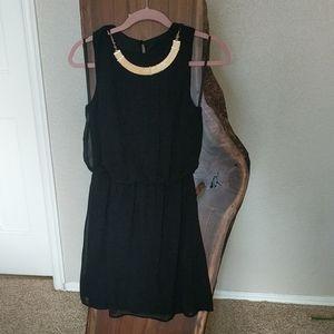 Black dress with gold color neckline piece